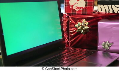 Online Christmas shopping with green screen laptop monitor