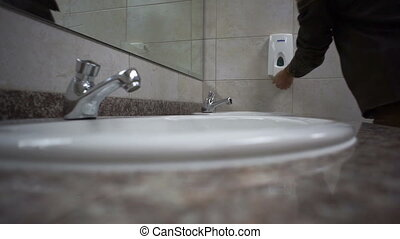 Public Bathroom Washing Hands - Close up shot of a man in a...