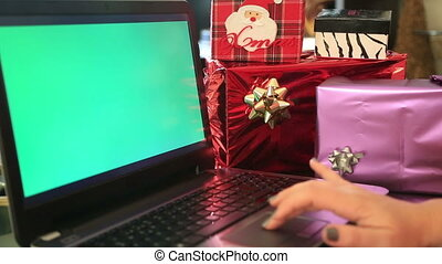 Christmas shopping online with green screen laptop monitor