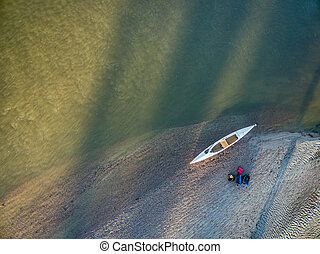 aerial view of canoe on river shore - aerial view of...