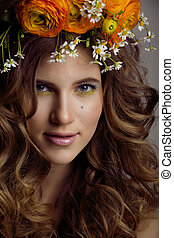 Beauty young woman with flowers and make up close up, real...