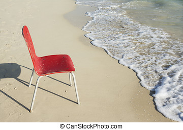 An Empty Single Red Chair at Beach - An Empty Single Red...