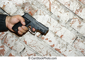 Crime Story Concept - Crime concept. Hand holding a pistol...