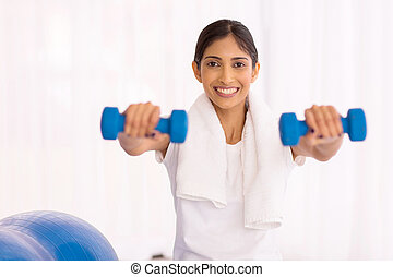 indian woman working out with dumbbells