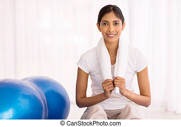 young indian woman at the gym