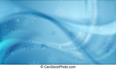 Falling snowflakes on blurred wavy background