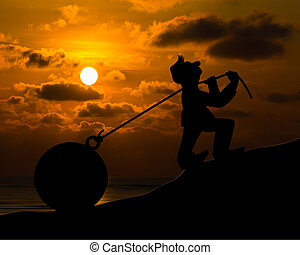 Man with pulling a heavy load ball silhouette