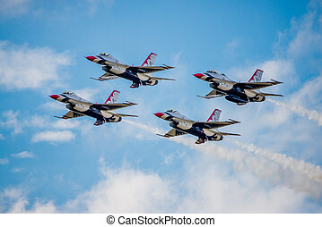 USMC F-16 Thunderbirds flying in a diamond formation
