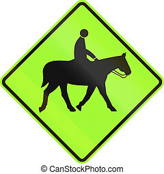 New Zealand road sign - Watch for equestrians, fluorescent...
