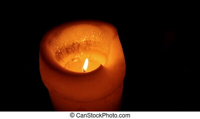 Candle burning in the dark - one Candle burning in the black...