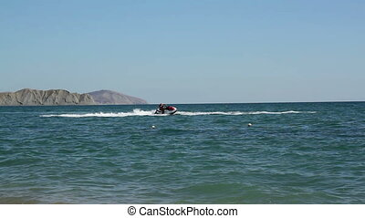 jet skiing on water at black sea