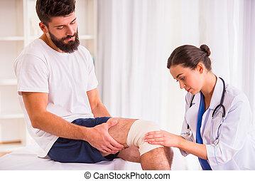 Injury man in doctor - Injury leg. Young man with injured...