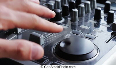 DJ Working with dj mixer - DJ working with an analog audio...