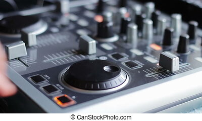 DJ Working with Sound mixing console - DJ working with an...