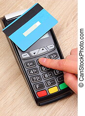 Hand of woman using payment terminal, enter personal...