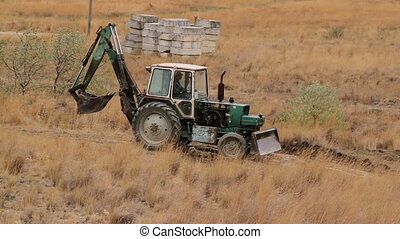 Tractor building a road in the desert - Building modern...