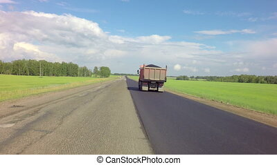 Truck transporting asphalt on the route of Altai Krai -...