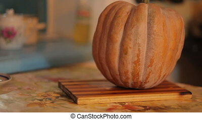 Pumpkin on table - orange Pumpkin on kitchen table at...