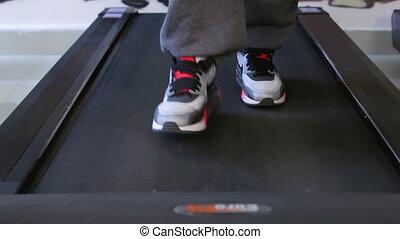 Bodyfitness workout. On treadmill.