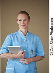 female doctor with tablet computer