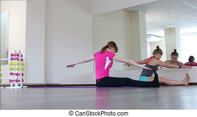 Two young women on Pilates - Girls do gymnastics in the...