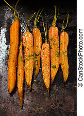 roasted carrots with tails, food close up