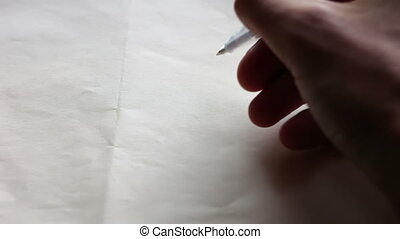 Draw a heart on paper - A man draws a heart pen on white...