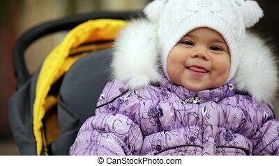 FullHD video of toddler baby girl  in her stroller