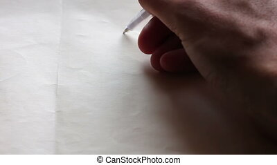 Writing I love you and draw a heart on paper - A man writes...