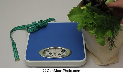Assortment of fresh vegetables on weights - Assortment of...