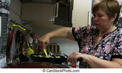 Woman Preparing Food In The Pan - woman preparing food in...