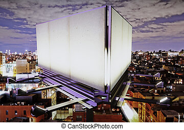 Blank billboard on the background of the city at night, mock...