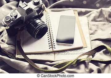 Blank cell phone, old style camera, blank diary and a book