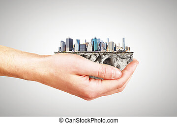 Whole world in one hand concept with man hand and part of...