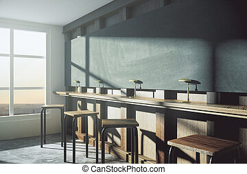 Modern college classroom with blank blackboard and window in floor at sunrise