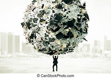 Businessman holding a ball of heap of papers and other office stuff, overworked concept