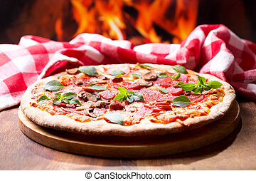 pizza with salami, ham and vegetables