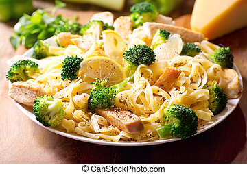 plate of pasta with chicken and broccoli