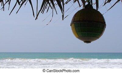 View on beach under Straw umbrella
