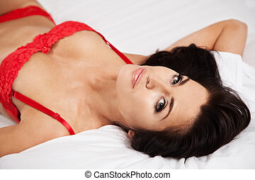 Young beautiful woman in her bed