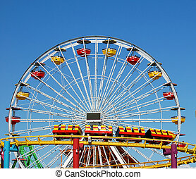 carnival - a ferris wheel and rollercoaster at an amusement...