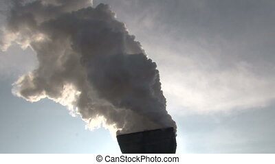 Billowing smoke from the pipes against the sky - The process...