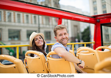 Attractive people - Young couple in the tour bus