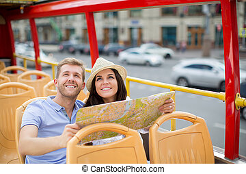Student - Young couple with a map