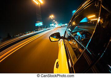 Car driving at night city