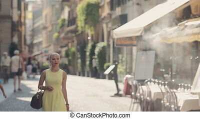Confident woman walks on courtyards of Milan - Confident...