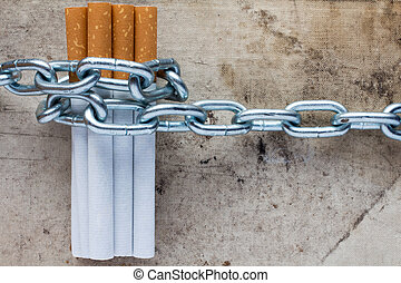 Quit smoking - Chained cigarettes. Conceptual image for stop...