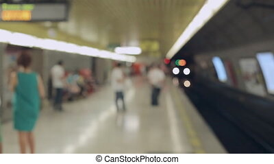 Blurred people waiting for subway at station of Milan -...