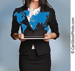Beautiful girl holding  tablet with blue world map