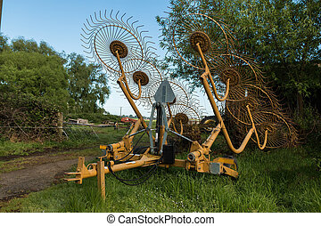 Farm Gear Hay Rake - Eight wheel hay rake waiting to be used...